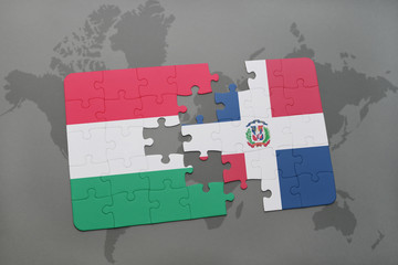 puzzle with the national flag of hungary and dominican republic on a world map