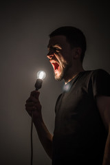 the man with the light bulb on black background