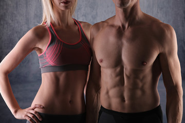 Fit couple, strong muscular man and slim woman . Sport, fitness ,workout concept.