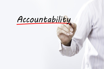 Businessman hand writing Accountability with red marker on trans