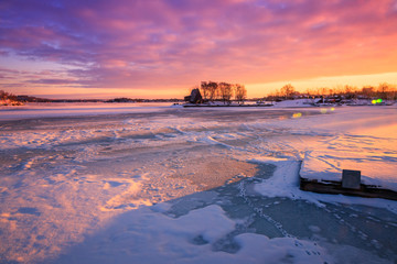 View of a frozen lake during sunrise in winter season. Location: Ramsey Lake, Ontario, Canada