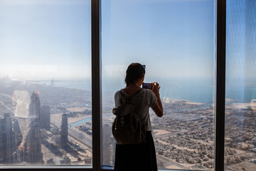 Girl Silhouette Taking Photos From Above In a Skyscraper. Sihlouete in a office building