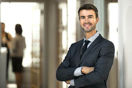 Business man CEO executive at office workplace standing confidently with staff at work