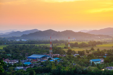 Mobile tower with mountain sunset background, Thailand countrysi