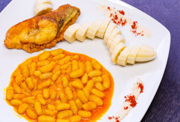 Palm Oil White Beans with Fish and Banana, top view zoom