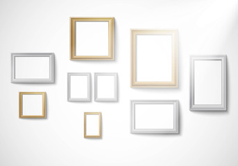 Blank gold and silver picture frame template isolated on wall with light Vector