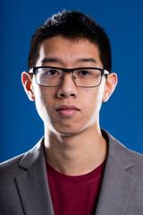 asian descent man with glasses portrait