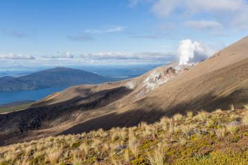 View of the Great Lake Taupo from Mt Tongariro with erupting craters Te Maari