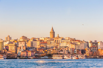 Sunset view of Galata tower and historical Karakoy district over Golden Horn gulf, Istanbul, Turkey
