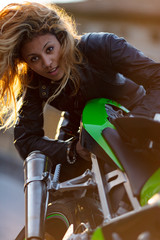 woman setting up her motorcycle to run