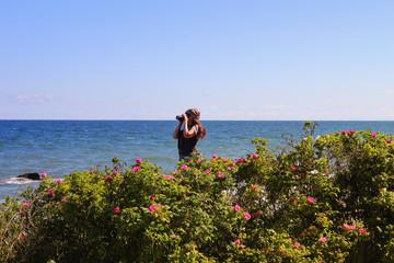 Tourist photographing on the island Rügen