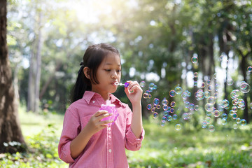 Asia cute girl Playing blowing balloons at the Park