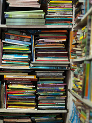 COLOR PHOTO OF BOOKS CRAMMED IN BOOKSHELF