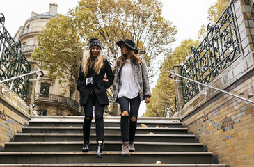 Paris, France, two young women walking downstairs