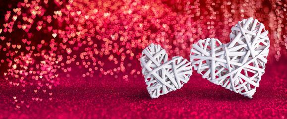 Obraz Valentines Day - Wicker Hearts On Red Shiny Background - fototapety do salonu