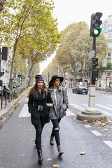 Paris, France, two young women walking on the street