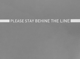 Conceptual safety Surface white line painted with letter massage