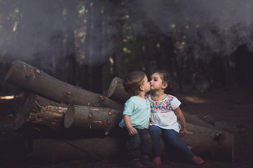 Kids kissing in msty forest