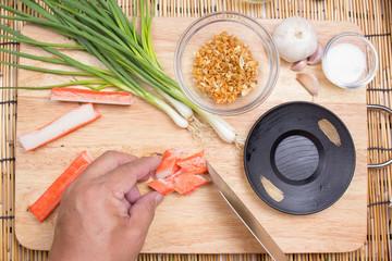 Chef cutting crab imitation