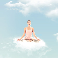 Woman doing a yoga posture on a cloud: Meditation posture - Lotus - Padmasana