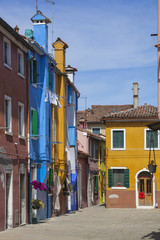 Colorful houses with tile roof in historical Burano district, Venice