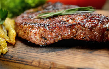 grilled juicy steak with rosemary.