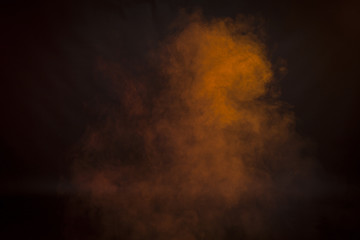 Orange  smoke in a dark room. Texture, background
