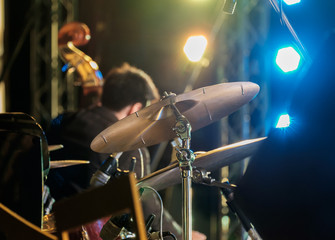 Music / View of cymbal of drum on stage at night. Shallow depth of field.