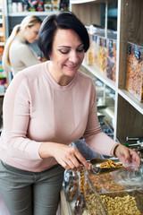 Woman selecting tea in store