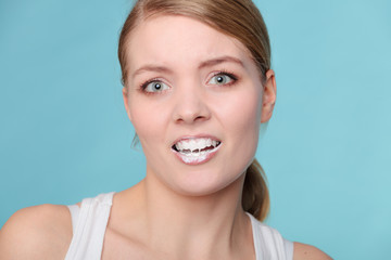 woman with toothbrush brushing cleaning teeth
