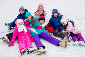 group of kids lying on the ice