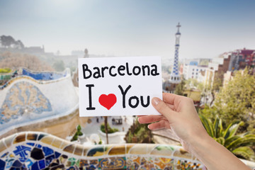 Barcelona I love You on paper in girl hand. Turistic and travel concept.
