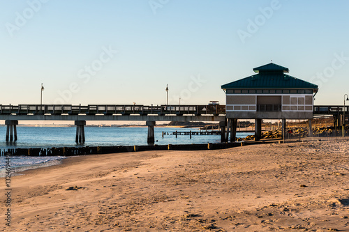 Morning Light On Fishing Pier With Sandy Beach At Buckroe In Hampton Virginia