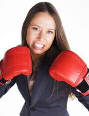 portrait of business woman boxing in red gloves. business activity