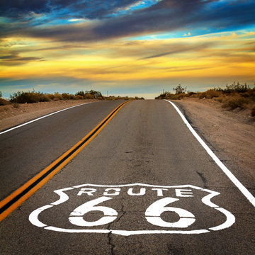 Route 66 sign on the floor of the road.