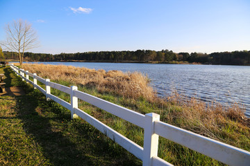 white picket fence by the lake