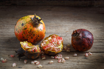 Pomegranate on wooden background.