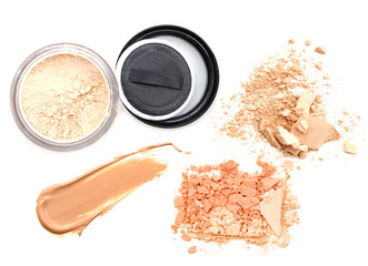 Face powder and brush over white background