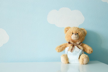 Toy bear dressed in diaper