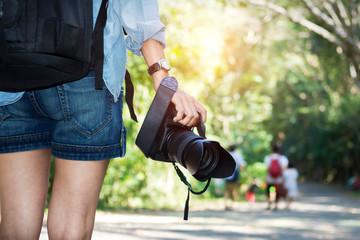 woman photographer taking photo outdoor