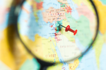 Syria on the world map with a magnifying glass