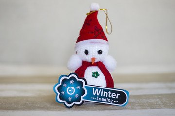 Blue loading sign and snowman