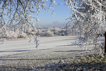 Beautiful fairytale snowy winter countryside with blue Sky in Central Bohemia, Czech Republic