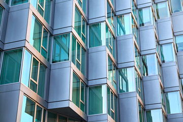 Modern building facade with window sections of aluminum, being tilted, getting an bay window feeling, in an apartment building in New York City Fototapete
