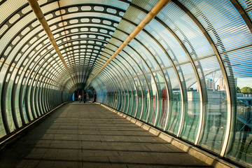 Foto op Canvas Tunnel Tunnel shapped modern Architecture tunnel with light and people at the end