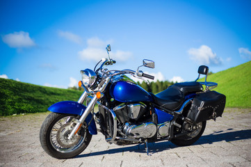 blue retro motorcycle on the road