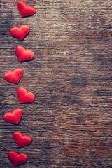 Red heart on wood background with space for Valentine Day.