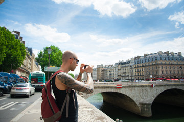 Man making a photo of a city using smart phone