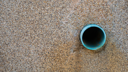 pipe or Drain tube in the wall .
