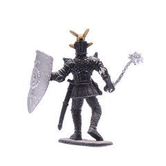 figurine a medieval knight with mace isolated on white